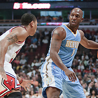 08 November 2010: Denver Nuggets' point guard #1 Chauncey Billups brings the ball upcourt against Chicago Bulls' point guard #1 Derrick Rose during the Chicago Bulls 94-92 victory over the Denver Nuggets at the United Center, in Chicago, Illinois, USA.