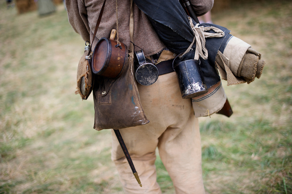 Brandon Booth of the 37th Virginia Infantry is heavy laden with equipment on the third day of the 149th Gettysburg Reenactment in Gettysburg, Pennsylvania on July 8, 2012.