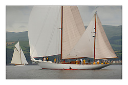 Belle Adventure, a 94' Bermudan Ketch nearing the finish of the first day's racing. a spectator in a canoe makes a close pass...This the largest gathering of classic yachts designed by William Fife returned to their birth place on the Clyde to participate in the 2nd Fife Regatta. 22 Yachts from around the world participated in the event which honoured the skills of Yacht Designer Wm Fife, and his yard in Fairlie, Scotland...FAO Picture Desk..Marc Turner / PFM Pictures