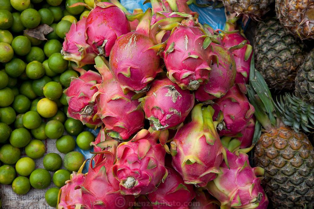 Luang Prabang, Laos. Morning food market. Limes, pineapple, and dragon fruit.