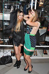 Left to right, ZARA MARTIN and AMBER ATHERTON at a party to celebrate the opening of the new Nicole Farhi global flagship store at 25 Conduit Street, London W1 on 19th September 2011.