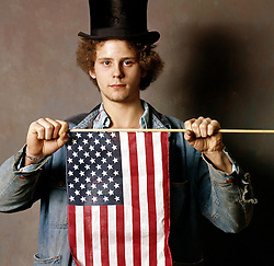Young hippie type character with american flag Americana