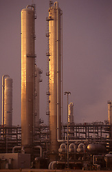 Stock photo of chemical plant towers at dusk