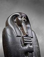 Ancient Egyptian greywacke sarcophagus lid of Ibi - late Period, 26th Dynasty (664-610BC). Egyptian Museum, Turin. Grey background<br /> <br /> Ibi was overseer of the priests of Thebes and chief steward of Nitocris, Divine Adoratrice of Amon during the reign of Psamtek I. The sarcophagus lid shows his hands emerging from a shroud to grasp the dfed-pillar, which allows him to rise to his feet again after resurrection. The lid weighs more than a ton and is finely sculpted. Despite the hardness of the greywacke stone the sarcophagus is made from, its makers have shown incredible skill creating a sarcophagus with intricate detail and a highly polished finish. .<br /> <br /> If you prefer to buy from our ALAMY PHOTO LIBRARY  Collection visit : https://www.alamy.com/portfolio/paul-williams-funkystock/ancient-egyptian-art-artefacts.html  . Type -   Turin   - into the LOWER SEARCH WITHIN GALLERY box. Refine search by adding background colour, subject etc<br /> <br /> Visit our ANCIENT WORLD PHOTO COLLECTIONS for more photos to download or buy as wall art prints https://funkystock.photoshelter.com/gallery-collection/Ancient-World-Art-Antiquities-Historic-Sites-Pictures-Images-of/C00006u26yqSkDOM