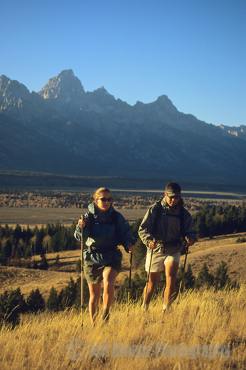 A young couple hikes in Grand Teton National Park, Jackson Hole, Wyoming.