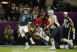 February 4, 2018 - Minneapolis, MN, USA - Philadelphia Eagles quarterback Nick Foles (9) gets a pass away under pressure from New England Patriots defenders Trey Flowers (98) and Lawrence Guy (93) in the first half on Sunday, February 4, 2018 at Super Bowl LII at U.S. Bank Stadium in Minneapolis, Minn. (Credit Image: © Jerry Holt/TNS via ZUMA Wire)