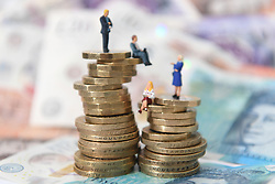 Embargoed to 0001 Thursday January 17 Models of men and women on a pile of coins and bank notes. A survey issued by NatWest has found nearly half of 18 to 24-year-olds say they fear more for the state of their finances in 2019 than they did last year.