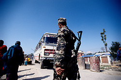 27 February 2005. On the road to Surket. Checkpoint set up by the Royal Nepal Army to counter potential Maoist activity. Everyone gets off the bus and walks through the checkpoint. The soldiers also search the passenger's luggages for weapons.