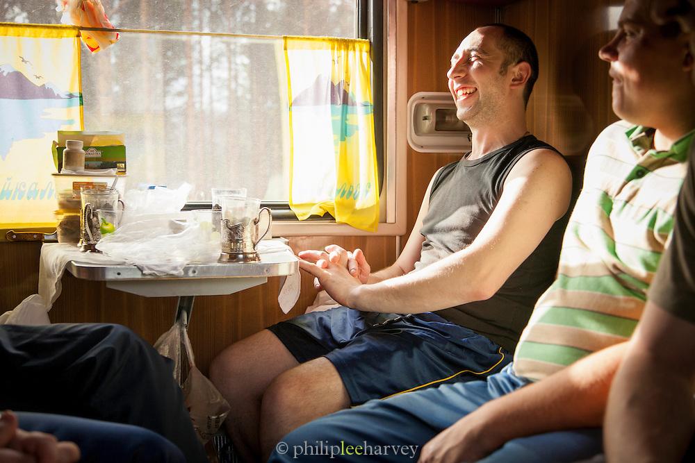 Passengers on-board the BAM (Baikal-Amur Mainline) Siberia, Russia