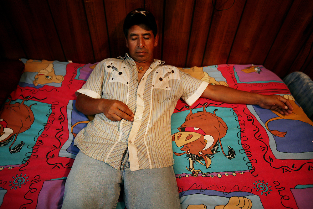 Celestino Cordova, of Hidalgo, Mexico rest in his bedroom after a hard days work of picking peaches. Cordova is married with one daughter and has worked as a migrant worker in S.C. for 17 years.