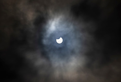 © Licensed to London News Pictures. 10/06/2021. London, UK. The partial eclipse is viewed through a gap in the clouds from central London. Photo credit: Peter Macdiarmid/LNP