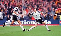 Dietmar Hamann celebrates scoring the German goal with Marko Rehmer. England 0:1 Germany, FIFA World Cup 2002 Qualifier Group Nine, Wembley Stadium, 7/10/2000. Credit: Colorsport / Stuart MacFarlane.