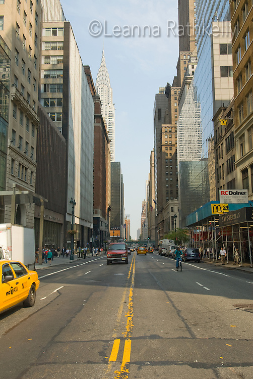 Downtown Manhattan streets look to the Chrysler Building in New York City, NY, USA.