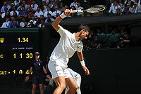 Tennis - 2019 Wimbledon Championships - Week Two, Friday (Day Eleven)<br /> <br /> Men's Singles, Semi-Final: Novak Djokovic (SRB) vs. Roberto Bautista Agut (ESP)<br /> <br /> Djokovic shows his frustration with his racket, on Centre Court.<br /> <br /> COLORSPORT/ANDREW COWIE