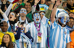 Fans of Argentina during the 2010 FIFA World Cup South Africa Round of Sixteen match between Argentina and Mexico at Soccer City Stadium on June 27, 2010 in Johannesburg, South Africa. Argentina defeated Mexico 3-1 and qualified for quarterfinals. (Photo by Vid Ponikvar / Sportida)