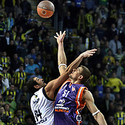 Fenerbahce Ulker's Kaya PEKER (L) and Power Electronics Valencia's Robertas JAVTOKAS (R) during their Euroleague Basketball Top 16 Game 2 match Fenerbahce Ulker between Power Electronics Valencia at Sinan Erdem Arena in Istanbul, Turkey, Thursday, January 27, 2011. Photo by TURKPIX