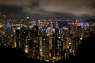 Hong Kong lights up at night with one of the largest collections of skyscrapers anywhere in the world.