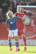 Aberdeen's Declan Gallagher (5) an St Johnstone Stevie May (7) battles for possession, tussles, tackles, challenges, during the Cinch Scottish Premiership match between Aberdeen and St Johnstone at Pittodrie Stadium, Aberdeen, Scotland on 18 September 2021.