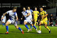 Kwesi Appiah (9) of AFC Wimbledon looking for a way past James Clarke (15) of Bristol Rovers during the EFL Sky Bet League 1 match between Bristol Rovers and AFC Wimbledon at the Memorial Stadium, Bristol, England on 23 October 2018.