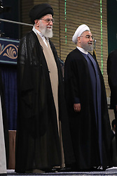 Handout photo - Iranian supreme leader Ayatollah Ali Khamenei (L) Iranian President Hasan Rouhani(R) stand during the swearing-in ceremony of Rouhani in Tehran, Iran, on August 3, 2017. Rouhani vowed to continue his efforts to end the country's isolation as he was sworn in by supreme leader Ayatollah Ali Khamenei to serve his second term following his re-election in May. Photo via Parspix/ABACAPRESS.COM