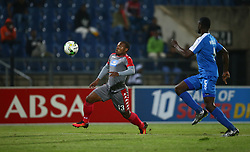 Thuso Phala of SuperSport United and Dennis Wieldiech of Maritzburg Utd go for the ball during the 2016 Premier Soccer League match between Maritzburg Utd and SuperSport United held at the Harry Gwala Stadium in Pietermaritzburg, South Africa on the 21st September 2016<br /> <br /> Photo by:   Steve Haag / Real Time Images