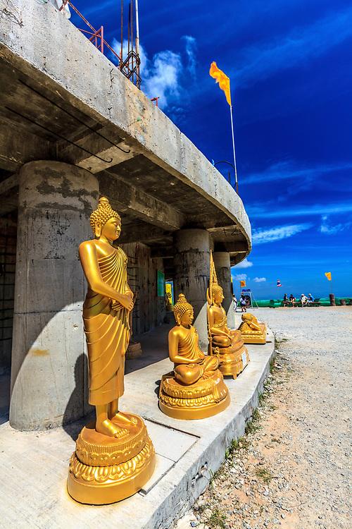 Statues in front of Phuket's Big Buddha in Phuket Island, Thailand.