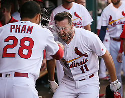 July 7, 2017 - St Louis, MO, USA - The St. Louis Cardinals' Paul DeJong (11) is doused by teammate Tommy Pham in the dugout after he hit a solo home run in the third inning against the New York Mets on Friday July 7, 2017, at Busch Stadium in St. Louis. The Mets won, 6-5. (Credit Image: © Chris Lee/TNS via ZUMA Wire)