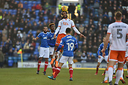 Blackpool Forward, Nathan Delfouneso (30) wins a header during the EFL Sky Bet League 1 match between Portsmouth and Blackpool at Fratton Park, Portsmouth, England on 24 February 2018. Picture by Adam Rivers.