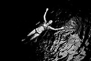SHOT 2/21/19 4:03:36 PM - Vesta Lingvyte of Denver, Co. floats on her back in the Cenote Acancun Azul near Panaba, Mexico. Panabá is a town and the municipal seat of the Panabá Municipality, Yucatán in Mexico. A cenote is a natural pit, or sinkhole, resulting from the collapse of limestone bedrock that exposes groundwater underneath. Especially associated with the Yucatán Peninsula of Mexico, cenotes were sometimes used by the ancient Maya for sacrificial offerings but are more commonly used today as tourist attractions for swimming, snorkeling and scuba diving. (Photo by Marc Piscotty / © 2019)