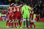 Gareth Bale of Wales leads the team huddle at the end of the match after they earn a 0-0 draw. Euro 2016 qualifying group B match, Wales v Bosnia- Herzegovina at the Cardiff city Stadium in Cardiff, South Wales on Friday 10th Oct 2014.<br /> pic by Andrew Orchard, Andrew Orchard sports photography.