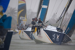 Phil Robertson leads Keith Swinton in the rain  during qualifying session 4 Monsoon Cup 2010. World Match Racing Tour, Kuala Terengganu, Malaysia. 4 December 2010. Photo: Subzero Images/WMRT