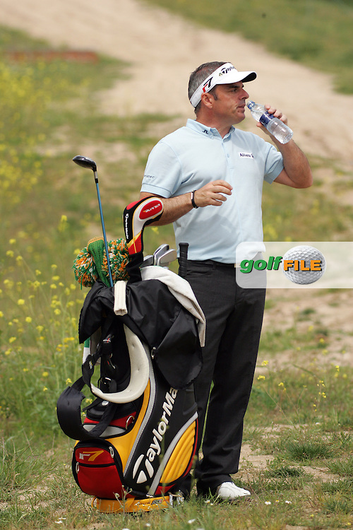 Paul McGinley takes a drink after landing his tee shot in the rough on the 15th hole in the Open de Espana in Madrid..Photo NEWSFILE/Eoin Clarke.(Photo credit should read Eoin Clarke/NEWSFILE)....This Picture has been sent you under the condtions enclosed by:.Newsfile Ltd..The Studio,.Millmount Abbey,.Drogheda,.Co Meath..Ireland..Tel: +353(0)41-9871240.Fax: +353(0)41-9871260.GSM: +353(0)86-2500958.email: pictures@newsfile.ie.www.newsfile.ie.FTP: 193.120.102.198..