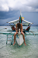 Hortense from France at the bow of a bangka boat anchored at Paradise Island, one of several stops in a day-long boat tour out of Port Barton, Palawan, Philippines.<br /> <br /> (July 7, 2019)