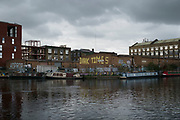 Graffiti at the junction between the Lea Navigational Canal and the Hertford Canal in East London, England, United Kingdom. This street art reads as slogans which are prophetic and political. (photo by Mike Kemp/In Pictures via Getty Images)