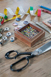 High angle view of haberdashery items on wooden table, Bavaria, Germany