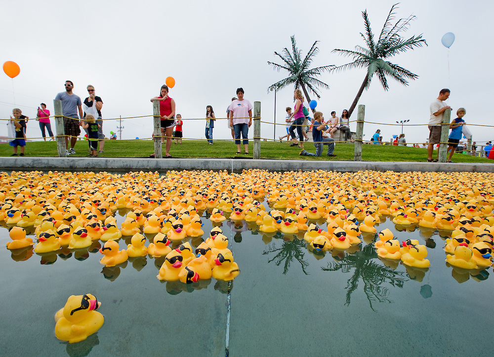 Thousands of rubber ducks float along the lazy river during Royís Grand 12th annual Duck Derby for Leadership Tomorrow Saturday morning at Island Oasis in Grand Island. Nearly 7,000 ducks raced through the lazy river to win prizes for their corresponding contestants. The event benefits Leadership Tomorrow, a nine-month program that identifies men and women who would do well in Hall County leadership positions.  (Independent/Matt Dixon)