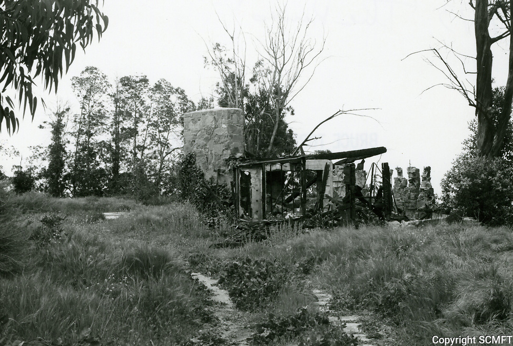 """1973 Burned out ruins of a house in """"The Pines"""". Occupied by Errol Flynn in 1958 when he appeared in a play at the Huntington Hartford Theater."""