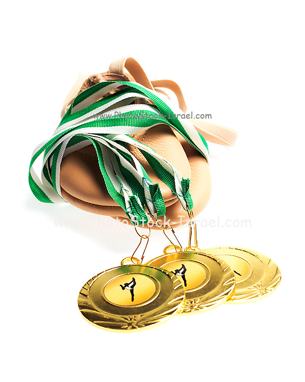Gold Medals with  Gym shoes on White background