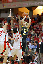18 January 2007: Kyle Wilson executes a fade a way jump shot with Levi Dyer and Anthony Slack defending. The Shockers of Wichita State were shut off by the Redbirds by a score of 83-75 at Redbird Arena in Normal Illinois on the campus of Illinois State University.