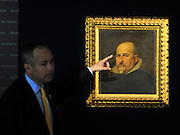 35559258© Licensed to London News Pictures. 27/10/2011. London, UK. Andrew McKenzie, Director of Old Masters talks about the painting. A previously unknown portrait by the Spanish artist Diego Rodriguez de Silva y Velazquez (1599-1660) is unveiled at Bonhams Auction House in London today, 27th October. The work is a portrait of a gentleman in a black tunic and white collar and is expected to fetch 2-3million GBP.  Photo: Stephen Simpson/LNP