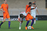 Adrian Bernabe of Spain (18) and Daishawn Redan of Netherlands (9)during the UEFA European Under 17 Championship 2018 match between Netherlands and Spain at the Pirelli Stadium, Burton upon Trent, England on 8 May 2018. Picture by Mick Haynes.