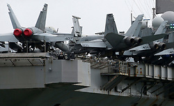 © Licensed to London News Pictures. 28/07/2017. The F-18 Hornet fighter aircraft  on board the USS George H.W. Bush (CVN 77) aircraft carrier as it anchors in Stokes Bay near Portsmouth Harbour ahead of a training exercise with British troops. The nuclear-powered behemoth can carry up 80 aircraft on its four-and-a-half acre flight deck, as well as 5,000 Navy personnel and aircrew. Photo credit: Jason Bryant/LNP