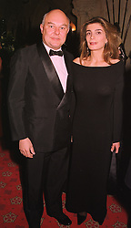 MR & MRS ROLF SACHS at a dinner in Berkshire on 19th November 1998.MME 46