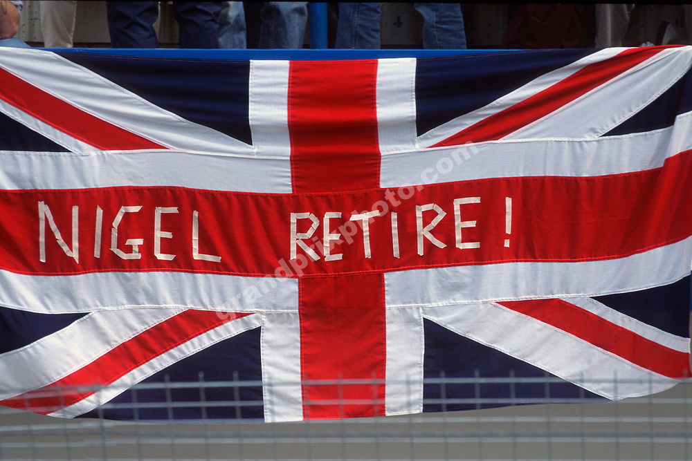 Spectators / fans with sign for Williams-Renault driver Nigel Mansell at the 1994 European Grand Prix in Jerez. Photo: Grand Prix Photo
