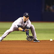 New York Yankees shortstop Derek Jeter (2) fields the ball for a throw to first base during a major league baseball game between the New York Yankees and the Tampa Bay Rays at Tropicana Field on Thursday, Sept. 17, 2014 in St. Petersburg, Florida. (AP Photo/Alex Menendez)