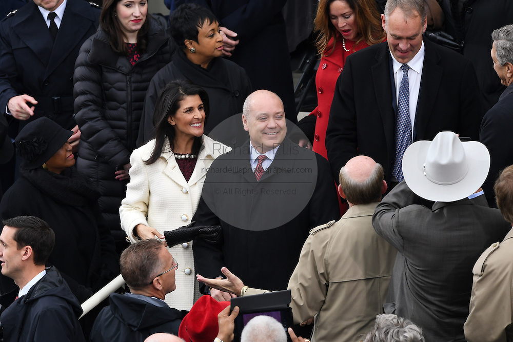 UN Ambassador and Former South Carolina Governor Nikki Haley arrives with her husband Michael Haley for the 68th President Inaugural Ceremony of President Donald Trump on Capitol Hill January 20, 2017 in Washington, DC.