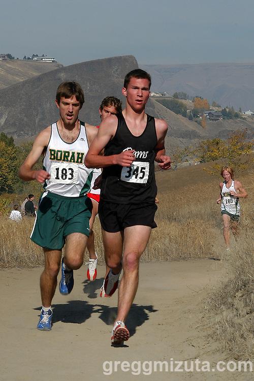 The lead pack (L to R: Borah senior Sean Huey, Boise senior Nick Bolinder, Highland senior Taylor Farnsworth, and Borah senior Sawyer Bosch) during the Idaho High School Cross Country Boy's 5A State Championship at Hells Gate State Park in Lewiston, Idaho on October 29, 2006.<br /> <br /> Farnsworth won the race (15:30.55) followed by Bolinder (15:53.47), Bosch (16:00.38), Boise senior Bryant Denson (16:05.62), Huey (16:16.57) and Mountain View senior K. Dailey (16:37.72).