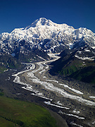 Aerial view of the Tokositna Glacier with Mt. McKinley or Denali beyond, Denali National Park, Alaska.