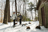 Jeanne and Dave Bockus of Tilton ventured out for a snowshoe hike on the Forest Trail during Winter Fest at Prescott Farm on Saturday afternoon.   (Karen Bobotas/for the Laconia Daily Sun)