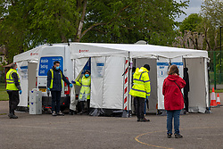 Licensed to London News Pictures. 25/05/2021. London, UK. Members of the public queue up at a community mobile testing site in Beaversfield Park Hounslow, West London as Downing Street issues advice to the public to avoid non-essential travel in and out of areas in England affected by the Indian variant including Hounslow in London. On Sunday the government increased surge testing in the area to help combat the new variant. Photo credit: Alex Lentati/LNP